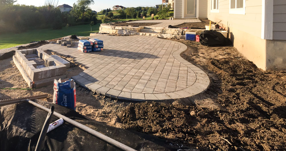 The organically shaped paver patio starting to shape up