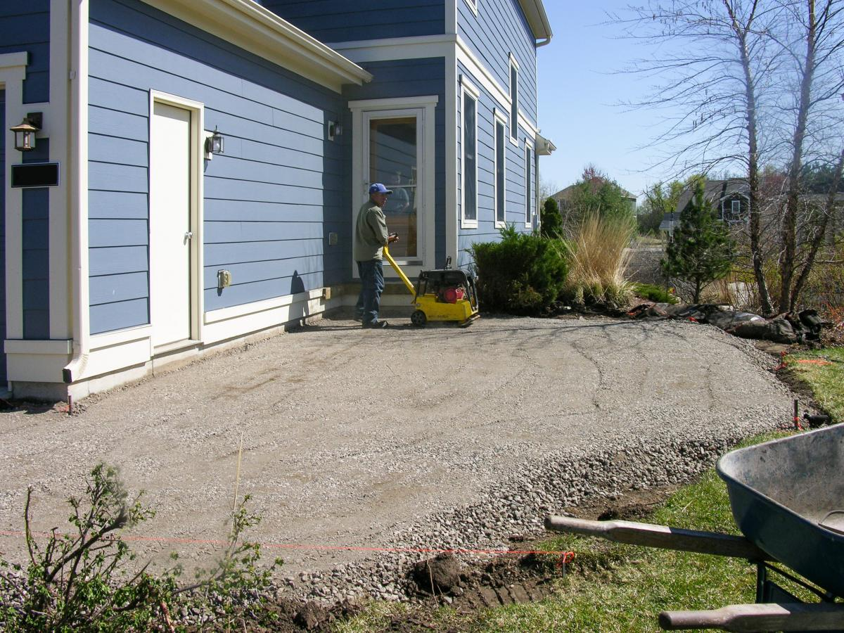The old hardscapes have been removed and the foundation laid for the new entryway.