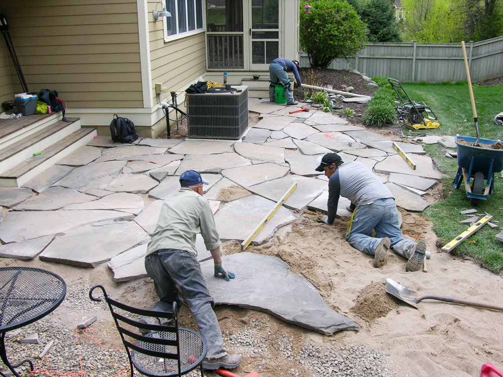 Puzzling the flagstone pieces together