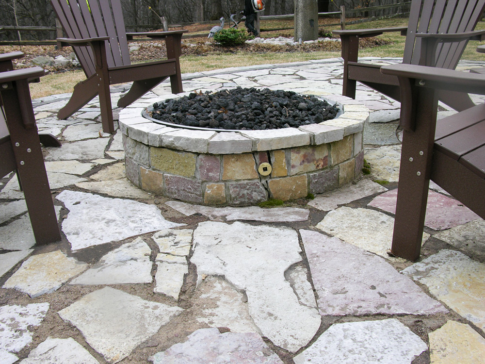 The cracked fire pit before replacement