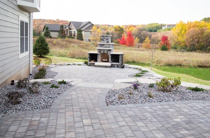 A paver patio with outdoor fireplace