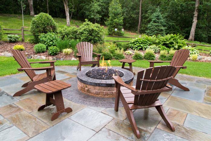 a patio and fire pit are given new life after a rebuild