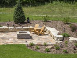 The fire pit adds a functional and aesthetic element to the yard.
