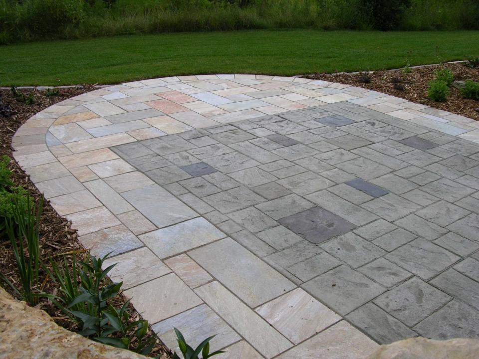 Stamped Patio With Natural Stone Surround