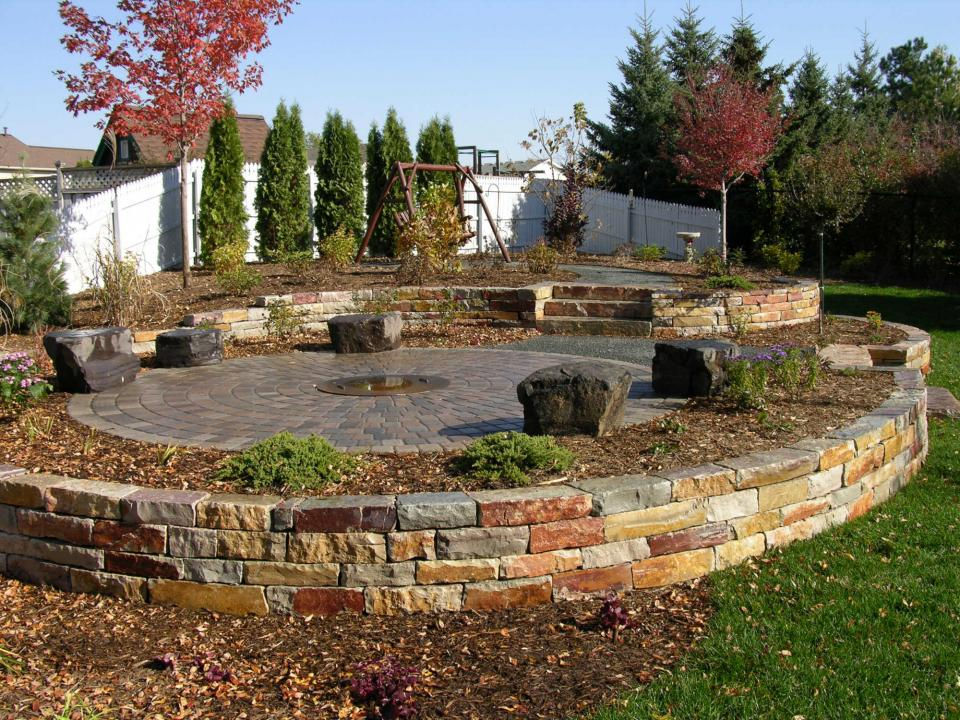 Firepit with Curved Retaining WallsOutdoor Living   Yardmasters Landscaping Company. Eden Outdoor Living Round Rock. Home Design Ideas